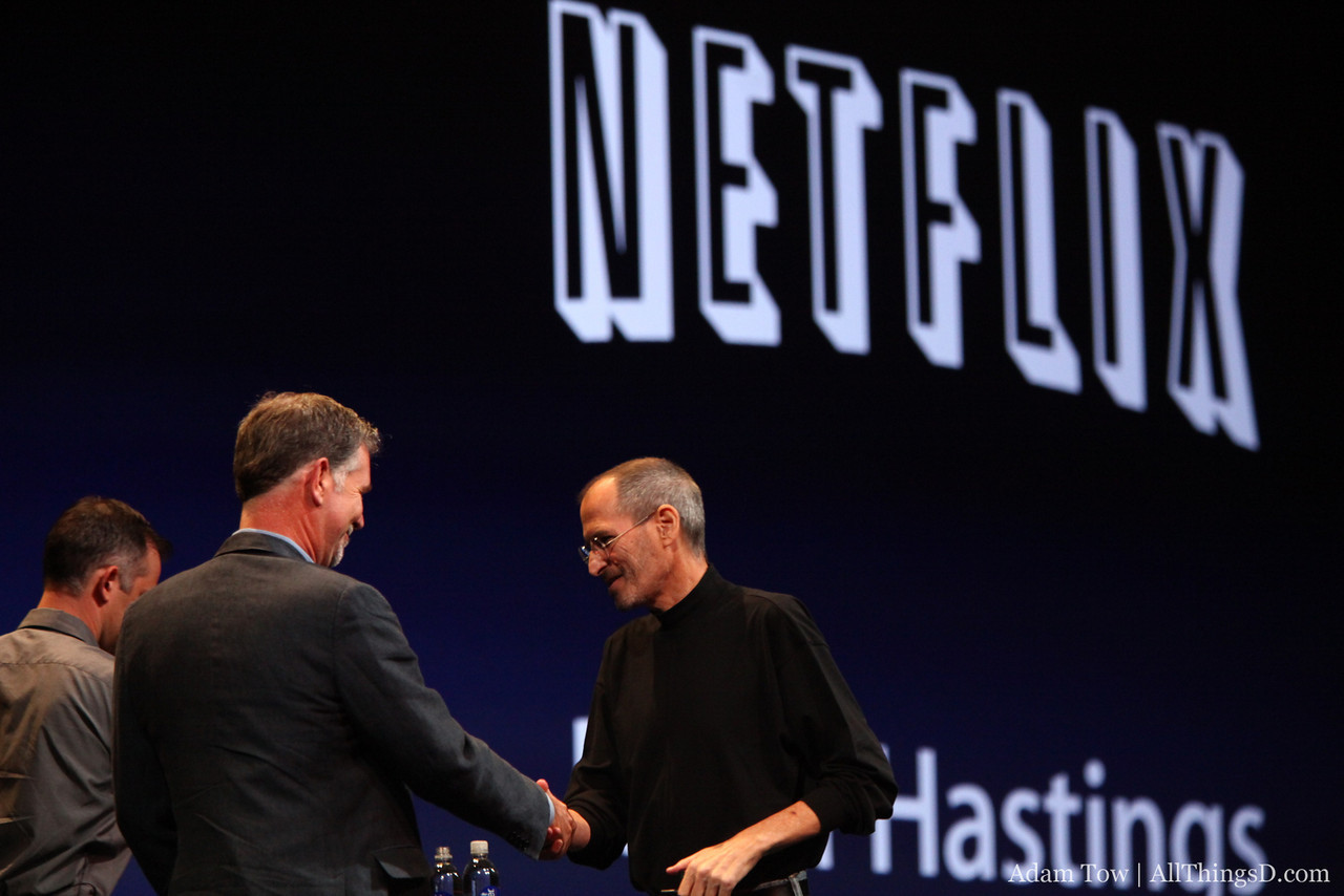 Jobs welcomes Netflix CEO Reed Hastings to the stage.