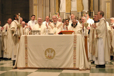Archbishop John F. Donoghue, center, the jubilarians on hand and priests from around the archdiocese pray the Our Father during the jubilee celebration of the Eucharist.  (Page 9, August 5, 2004 issue)