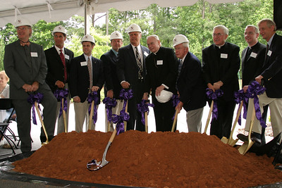 (L-r) Jere Wood, mayor of Roswell, Trey Sanders, vice president of Brasfiedl & Gorrie, Rev. Frank Bernat, senior associate minister of Roswell United Methodist Church, Craig Davisson, architect of Rink, Reynolds, Diamond, Fisher, Wilson, George Barrie, president and CEO of Catholic Construction Services, Inc., Archbishop John F. Donoghue, George Aulbach, vice-chairman, Msgr. Paul Reynolds, chancellor for the Archdiocese of Atlanta, Father Frank McNamee, pastor of St. Peter Chanel, Roswell, and Gary Meader, CFO for the Archdiocese of Atlanta, all take part in the official ground-breaking under a tent, yards away from the actual site.