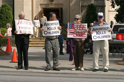 Archbishop John F. Donoghue, far left, a staunch supporter of pro-life issues, stands with other area Catholics along Peachtree Road in front of the Cathedral of Christ the King, Atlanta, protesting abortion during the Oct. 2003 Life Chain.   (Page 13, October 9, 2003 issue)