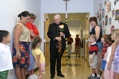 Archbishop John F. Donoghue received a warm welcome from young and old alike following an August 2004 school Mass at St. Catherine of Siena School, Kennesaw.