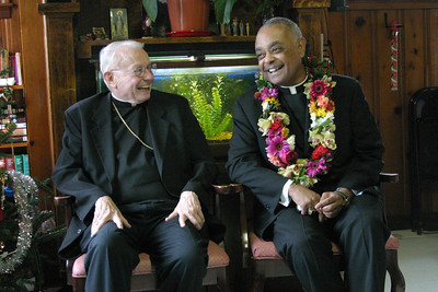 Archbishop John F. Donoghue, left, and Archbishop Wilton Gregory were special guests of the Missionaries of Charity at the Gift of Grace House during a December 2004 visit.  (Page 5, December 16, 2004 issue)