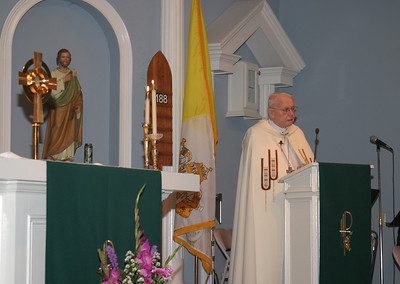 Archbishop John F. Donoghue speaks to the people of St. Matthew Church, Winder, about the importance of Eucharistic adoration during a benediction service, Sept. 5.  (Page 10, September 11, 2003 issue)