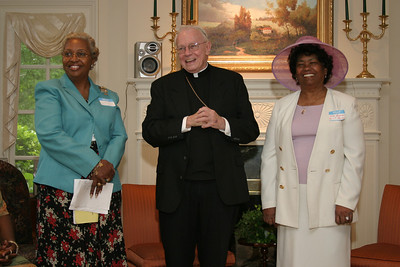 Archbishop John F. Donoghue, center, hosted an annual luncheon for Atlanta Archdiocesan Council of Catholic Women members. In this 2004 photo he shares a humorous moment with president Celeste Ganey, left, and executive vice president May Barron.