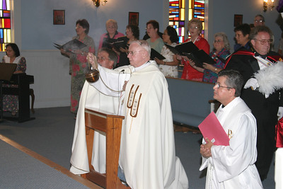 Archbishop John F. Donoghue censes the altar holding the Eucharist during first Friday adoration and benediction at St. Matthew Church, Winder.  (Page 10, September 11, 2003 issue)
