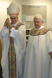 Archbishop John F. Donoghue, left, stands with Msgr. Walter J. Donovan prior to the Mass of dedication.  The new high school bearing the name of the 87-year-old priest is less than five miles from St. Joseph School, the school he helped start as a 32-year-old pastor of the Athens parish.   Page 18, October 2, 2003 issue)