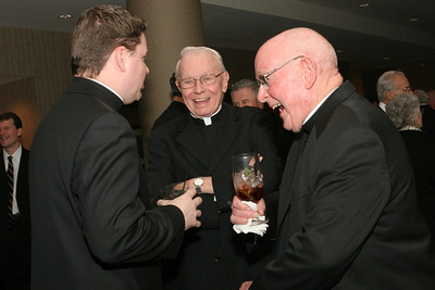 Father Bryan, left, chaplain for the Catholic Center at Emory University, Atlanta, shares a humorous moment with Archbishop-emeritus John F. Donoghue, center, and Msgr. R. Donald Kiernan, pastor of All Saints Church, Dunwoody.  (Page 16, February 22, 2007 issue)
