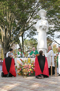 Archbishop John F. Donoghue, center, is the main celebrant during the outdoor Mass that followed the recitation of the rosary on the grounds of Our Lady of Vietnam Church, Oct. 24.  (Page 3, November 11, 2004 issue)