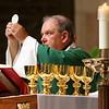 Arcbishop Hebda consecrates the Eucharist. Dave Hrbacek/The Catholic Spirit