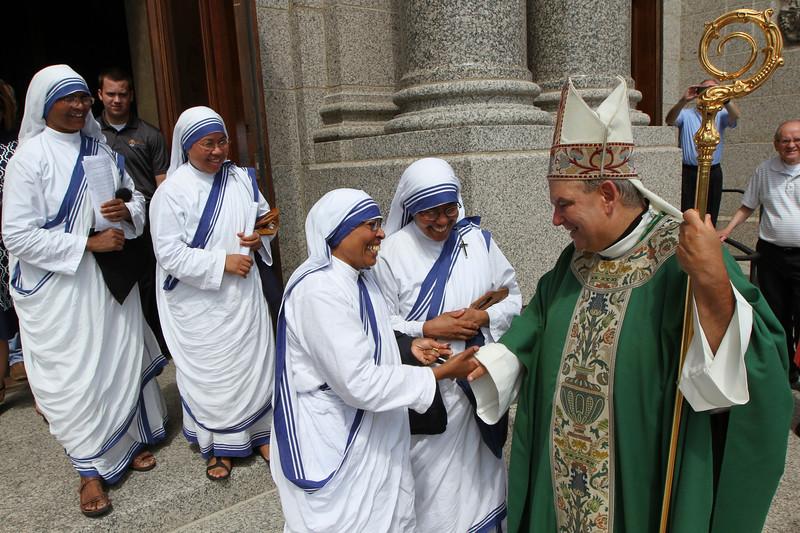 Missionaries of Charity greet Archbishop Hebda after Mass. Dave Hrbacek/The Catholic Spirit