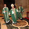 Archbishop Hebda makes his way out of the sacristy with Deacons Russ Shupe, left, and Phil Stewart. Dave Hrbacek/The Catholic Spirit