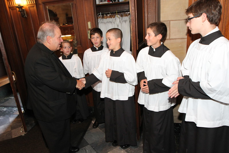Archbishop Bernard Hebda greets altar servers in the sacristy of the Cathedral of St. Paul before celebrating his first Mass at the Cathedral July 12. Dave Hrbacek/The Catholic Spirit