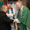 Archbishop Hebda greets Msgr. Aloysius Callaghan, rector of the St. Paul Seminary, in the sacristy before Mass. Joining them is Father Paul LaFontaine, a retired priest currently serving at the seminary. Dave Hrbacek/The Catholic Spirit