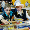 Paula Griggs, left, and Bill Griggs of Chadron, Neb., try out various leather stamps from Chuck Smith Tools, a California-based company, during the Rocky Mountain Leather Trade Show Friday at the Holiday Inn Convention Center.