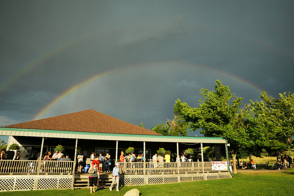 A double rainbow appears in the sky after a brief storm shower passes over the area Friday afternoon at the Big Horn Equestrian Center.