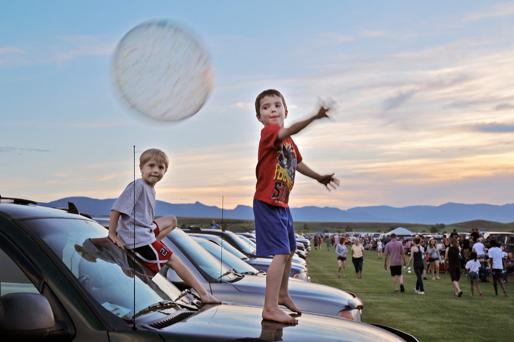 Ryder Charest, left, and Josiah Holst, both 5, play with a ball on top of a truck during the fireworks celebration Friday evening at the Big Horn Equestrian Center.