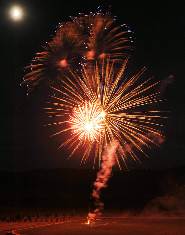 Fireworks explode over the polo fields during the fireworks celebration on Independence Day Friday night at the Big Horn Equestrian Center. The Sheridan Press Justin Sheely.