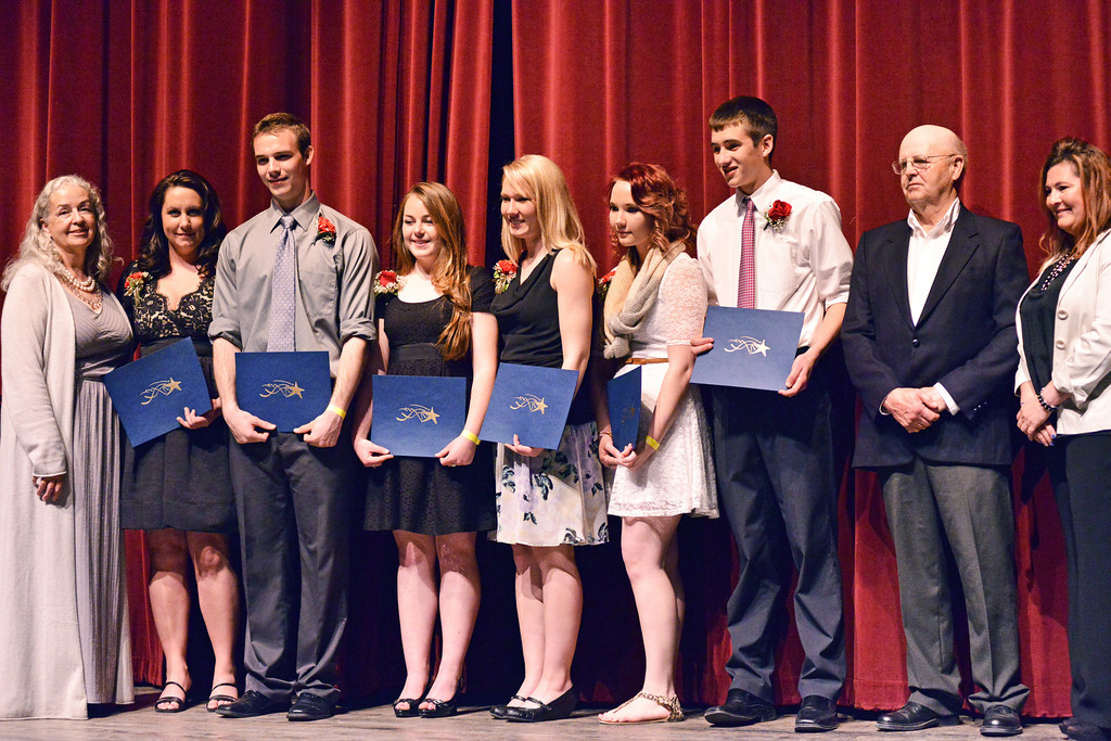 The 2014 Keys to the Stone Honorees are presented during the Keystone Awards Thursday at the WYO Theater. From left, Sheridan College Director of Development Linda Lawrence, SC student Bobbi Mitzel, SHS student Tyler Julian, BHHS student Hanna Caiola, A-C HS student Shayna Kretschman, FMHS student Harley Borzenski, and TRHS student Casey Caywood. Standing next to the honorees on the far right, Paddy Bard, left, and Bobbi Neeson of the Perkins Foundation. The Sheridan Press|Justin Sheely