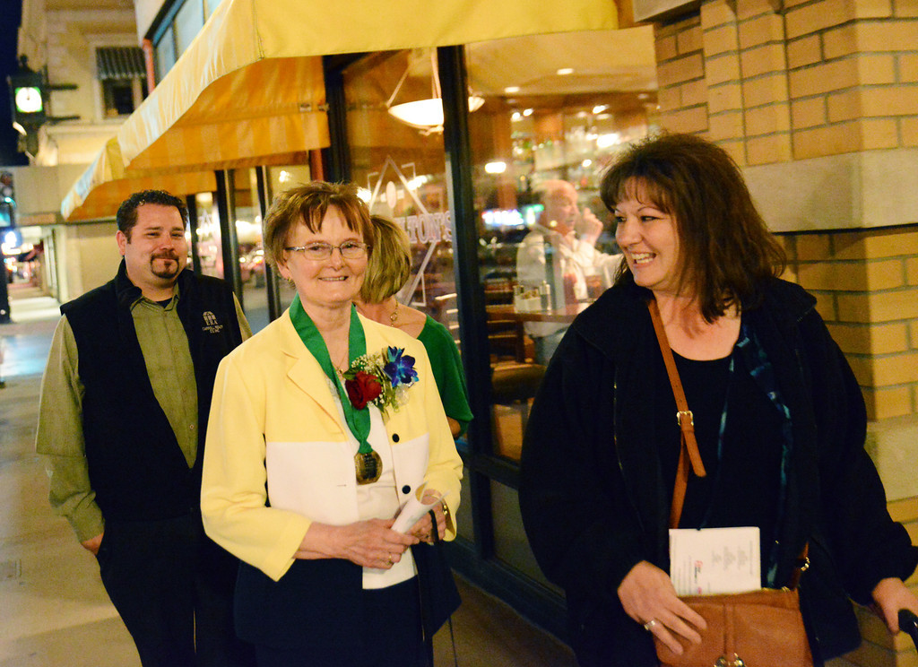 Keystone Honoree Dixie See, middle, walks to the post-ceremony party at Frackelton's Restaurant after the Keystone Awards Thursday night. The Sheridan Press|Justin Sheely