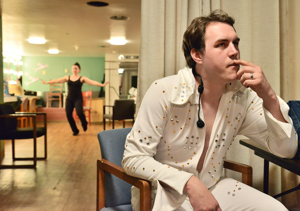Stefan Cook of the Sheridan College Theater Department contemplates his role as Elvis as a dancer practices in the dressing room during the Keystone Awards Thursday at the Sheridan WYO Theater. Cook later performed as Elvis during the honoring of Dixie See. The Sheridan Press|Justin Sheely