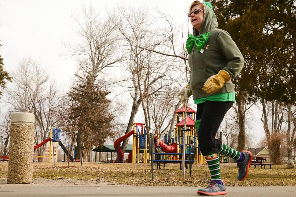 Carmen Christian does the loop for the 1-mile race during the Sheridan Jaycees' Run 'Till You're Green fun run event Saturday morning at Kendrick Park. Justin Sheely/The Sheridan Press.