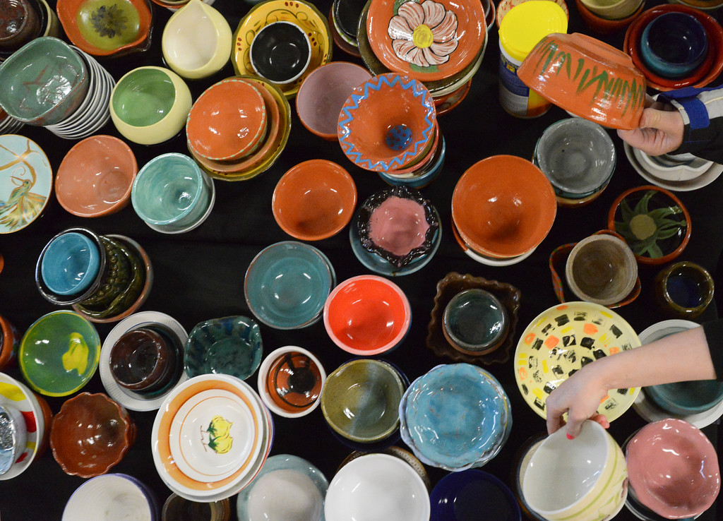 Justin Sheely | The Sheridan Press<br /> Guests pick out bowls for their chili during the VOA's Empty Bowl chili dinner fundraising event Thursday at the Sheridan County Fairgrounds exhibit hall. The event benefits the Sheridan Community Shelter. This year's event saw record breaking attendance with more than 850 guests.