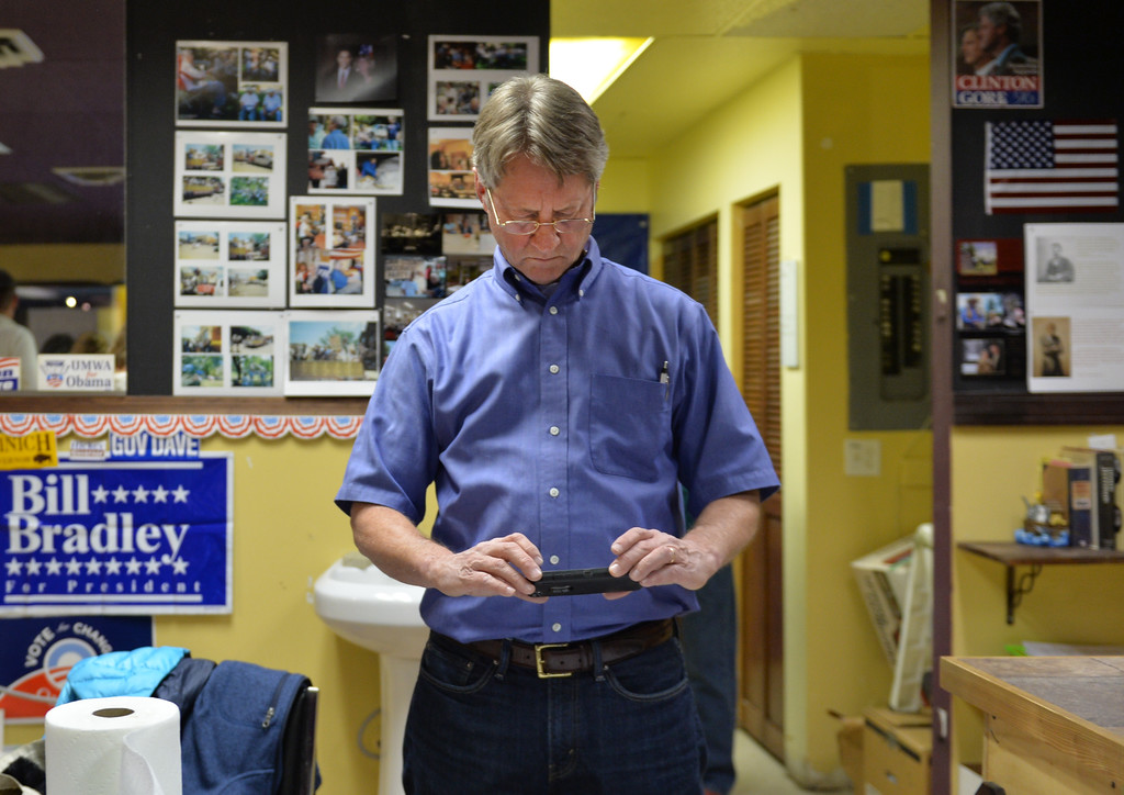Justin Sheely | The Sheridan Press<br /> House District 51 Democratic candidate Hollis Hackman looks up the latest election results on his phone Tuesday night at the Sheridan County Democrats Headquarters in Sheridan.