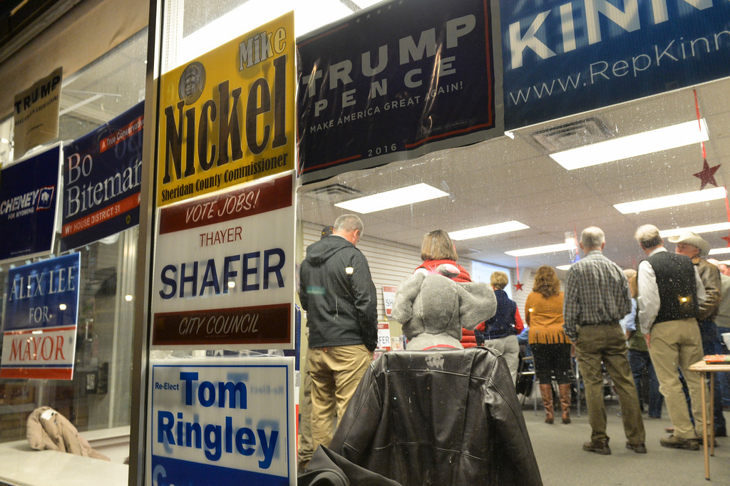 Justin Sheely | The Sheridan Press<br /> Campaign signs are displayed on the glass wall during the General Elections event Tuesday night at the Sheridan County Republican Headquarters on Main Street in Sheridan.