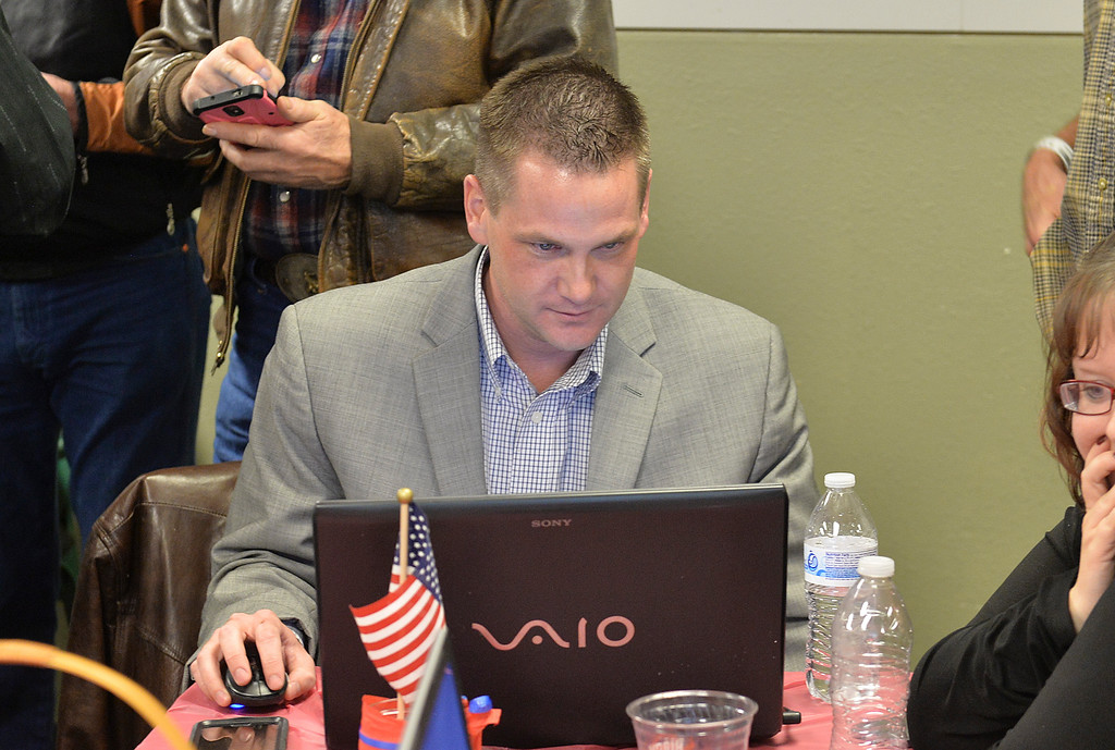 Justin Sheely | The Sheridan Press<br /> Republican candidate for HD 51 Bo Biteman monitors results during the General Elections event Tuesday night at the Sheridan County Republican Headquarters on Main Street in Sheridan. Biteman won over democrat Hollis Hackman.