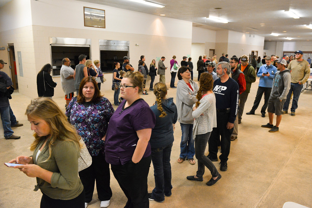 Justin Sheely | The Sheridan Press<br /> Voters wait in the registration line with less than two hours left before the polls close Tuesday night at the Sheridan County Fairgrounds.
