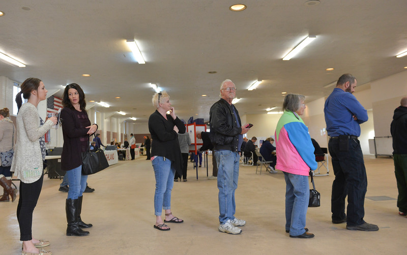 Justin Sheely | The Sheridan Press<br /> Sheridan voters line up by the registration table at the polling station in the Sheridan County Fairgrounds for the General Elections Tuesday morning.