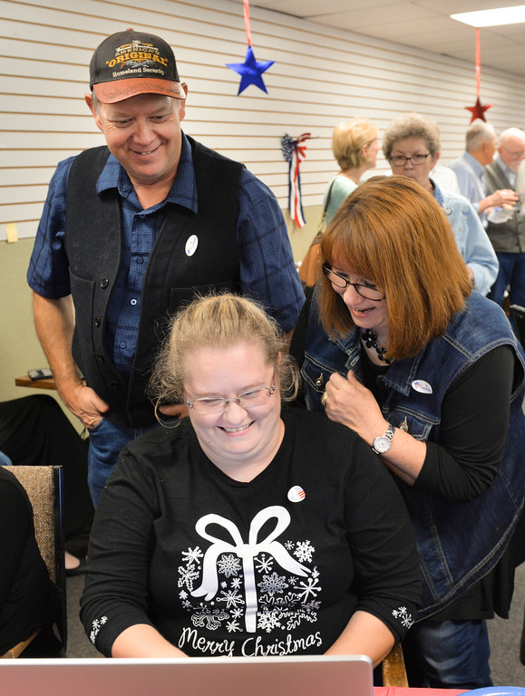 Justin Sheely | The Sheridan Press<br /> Rep. Mark Jennings, R-Sheridan, left, and daughter Holly Jennings, wife Dana Jennings, right, watch updated results during the General Elections event Tuesday night at the Sheridan County Republican Headquarters on Main Street in Sheridan.