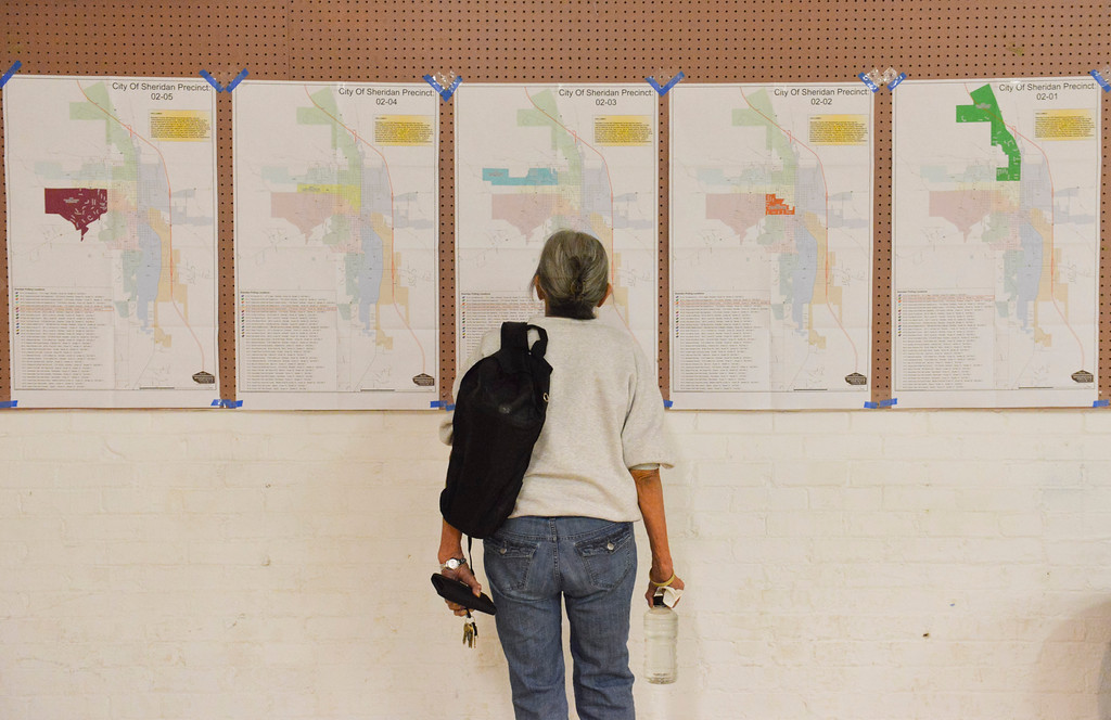 Justin Sheely | The Sheridan Press<br /> A woman studies a precinct map of the city of Sheridan Tuesday night at the Sheridan County Fairgrounds.