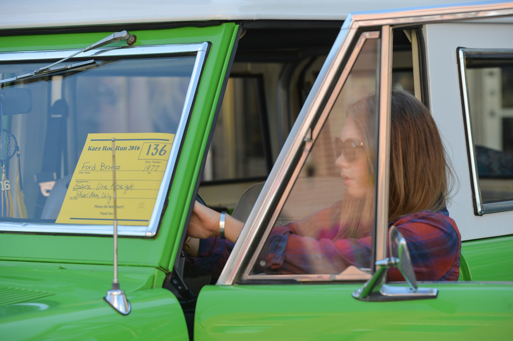 Justin Sheely | The Sheridan Press<br /> Sarah Von Krosigk puts up a sign inside her '77 Ford Bronco during the Karz Rod Run car show Saturday morning on Main Street. The show had more than 160 entries this year – one of the fullest in recent years.