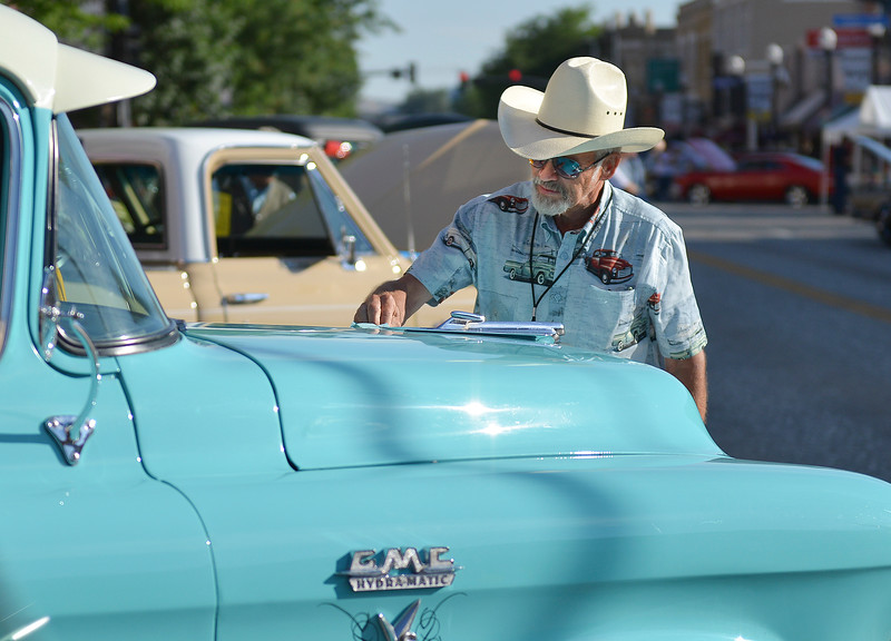 Justin Sheely | The Sheridan Press<br /> Gary Grubb wipes off the hood of his '55 GMC half ton pickup during the Karz Rod Run car show Saturday morning on Main Street. The show had more than 160 entries this year – one of the fullest in recent years.