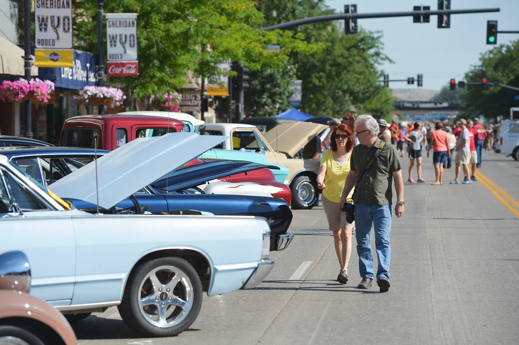 Justin Sheely | The Sheridan Press<br /> Classic car enthusiasts walk along Main Street during the Karz Rod Run car show Saturday morning. The show had more than 160 entries this year – one of the fullest in recent years.