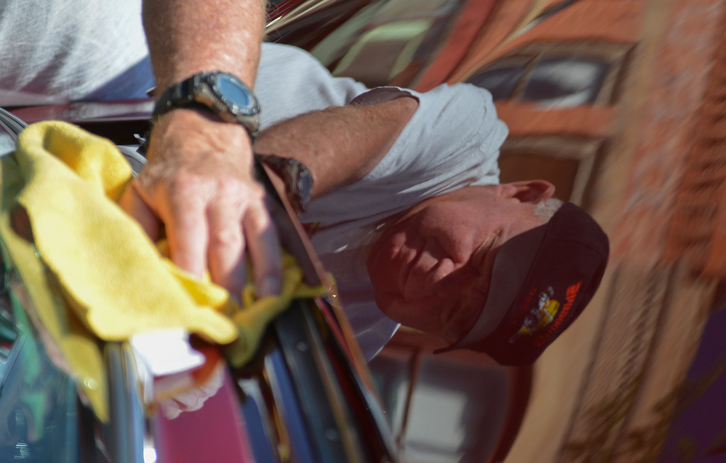 Justin Sheely | The Sheridan Press<br /> Paul Steffey of Casper polishes off the hood of his '56 Ford Fairlane during the Karz Rod Run car show Saturday morning on Main Street. The show had more than 160 entries this year – one of the fullest in recent years.