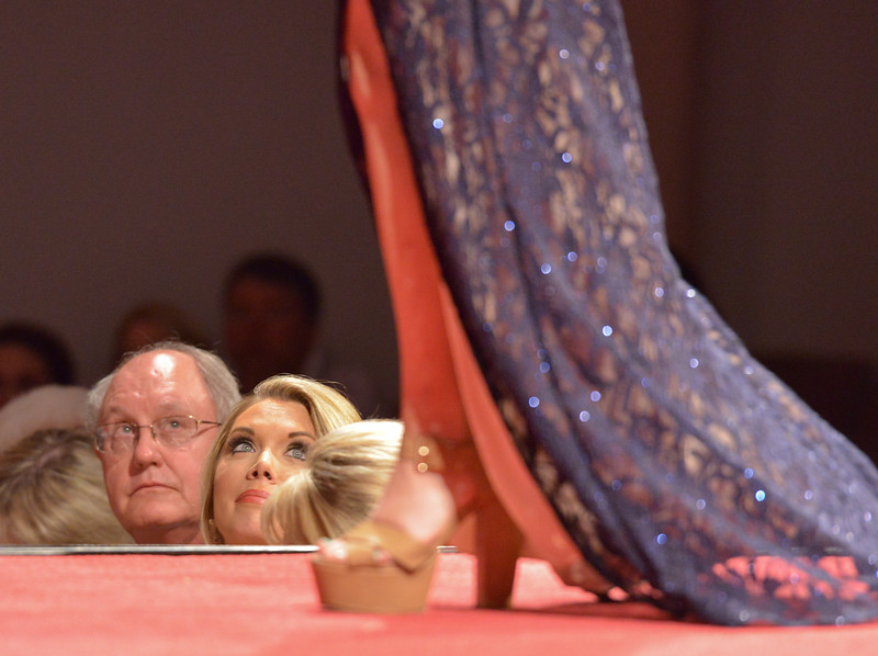 Justin Sheely | The Sheridan Press<br /> Judges look on as a contestant walks the stage for the evening gown segment during the 2016 Miss Wyoming pageant Saturday night at the WYO Theater. Miss South Central Jordyn Hall was crowned as the 2016 Miss Wyoming to represent the state during the Miss USA 2016 competition.