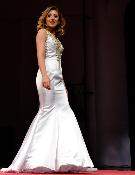 Justin Sheely | The Sheridan Press<br /> Miss Wind River Jaquelynn Dahlstedt twirls for the evening gown segment during the 2016 Miss Wyoming pageant Saturday night at the WYO Theater. Miss South Central Jordyn Hall was crowned as the 2016 Miss Wyoming to represent the state during the Miss USA 2016 competition.