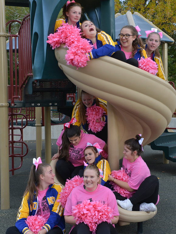 Justin Sheely | The Sheridan Press<br /> Sheridan High School cheerleaders pose themselves on a spiral slide for a photo during The Link – Partners in Pink event Saturday at Whitney Commons.
