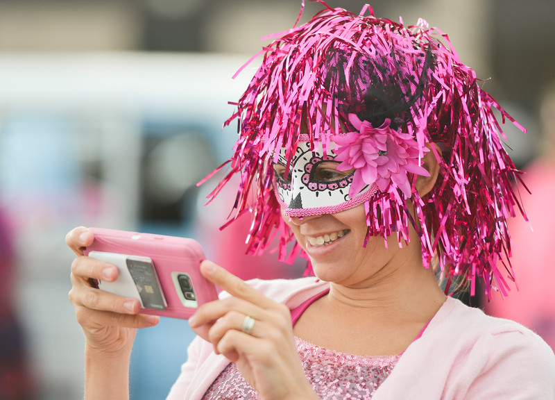 Justin Sheely   The Sheridan Press<br /> Georgia Knauss snaps a photo of her family during The Link – Partners in Pink event Saturday at Whitney Commons.