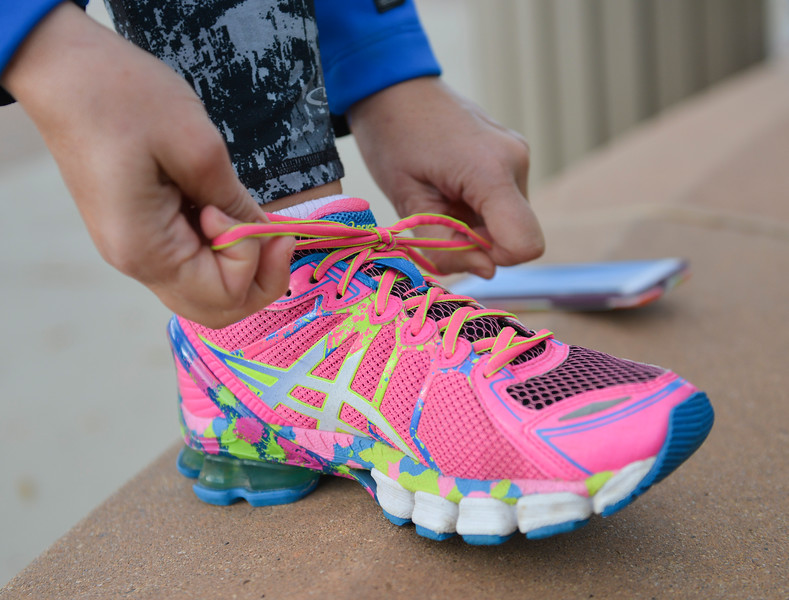 Justin Sheely   The Sheridan Press<br /> A runner tightens her shoes during The Link – Partners in Pink event Saturday at Whitney Commons.