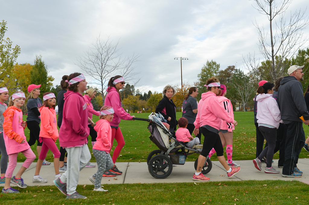Justin Sheely | The Sheridan Press<br /> Supporters march out of the park during The Link – Partners in Pink event Saturday at Whitney Commons.