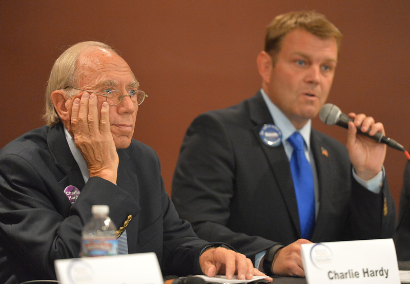 Justin Sheely | The Sheridan Press<br /> Democratic candidate for U.S. Congress Charlie Hardy listens as Darin Smith speaks during the Sheridan County of Commerce's Candidate Forum Tuesday night at the Sheridan Wesleyan Church.