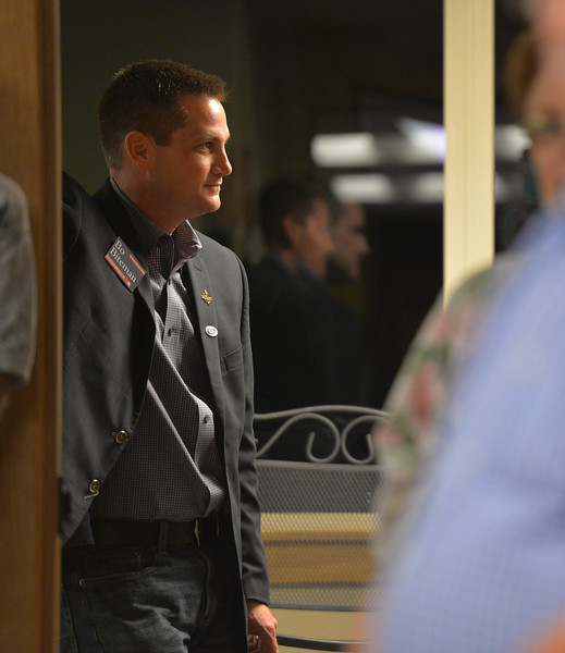Justin Sheely | The Sheridan Press<br /> Republican candidate for House District 51 Bo Biteman stands in the hallway as U.S. congressional candidates speak during the Sheridan County of Commerce's Candidate Forum Tuesday night at the Sheridan Wesleyan Church.