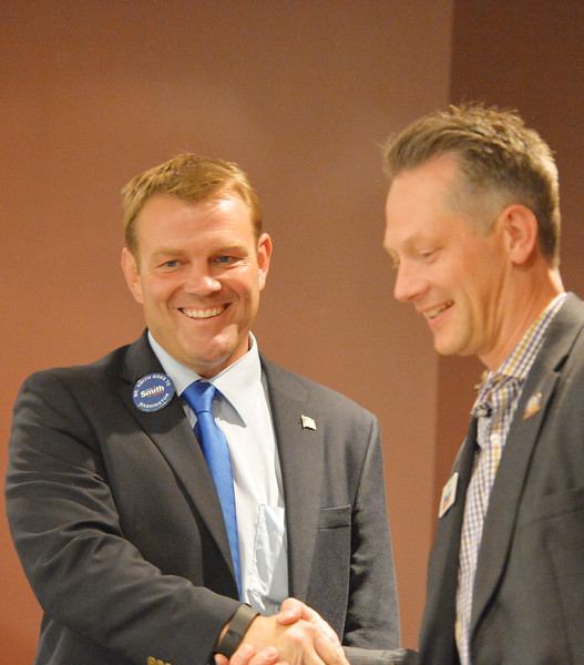 Justin Sheely | The Sheridan Press<br /> U.S. Congressional candidates Darin Smith, left, and Tim Stubson, R - Casper, shake hands during the Sheridan County of Commerce's Candidate Forum Tuesday night at the Sheridan Wesleyan Church.