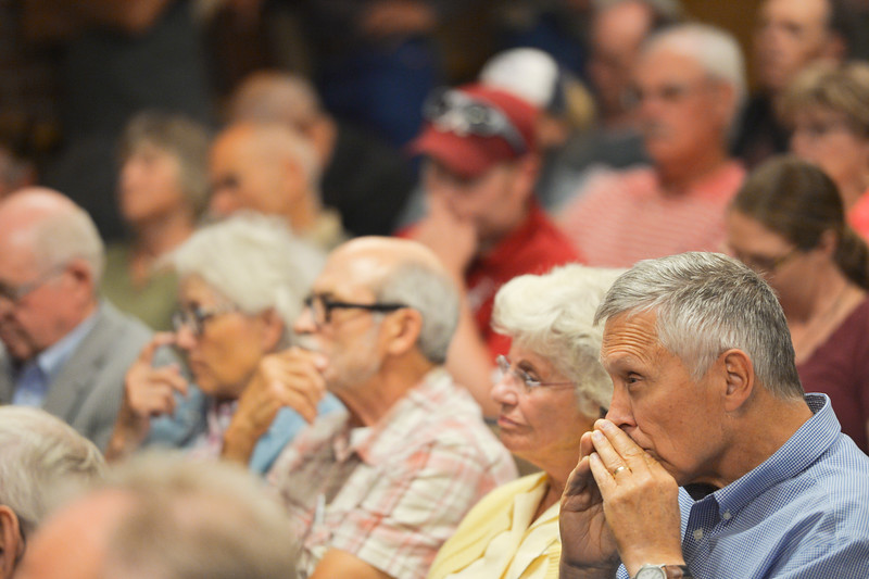 Justin Sheely | The Sheridan Press<br /> Audience members listen to candidates during the Sheridan County of Commerce's Candidate Forum Tuesday night at the Sheridan Wesleyan Church.