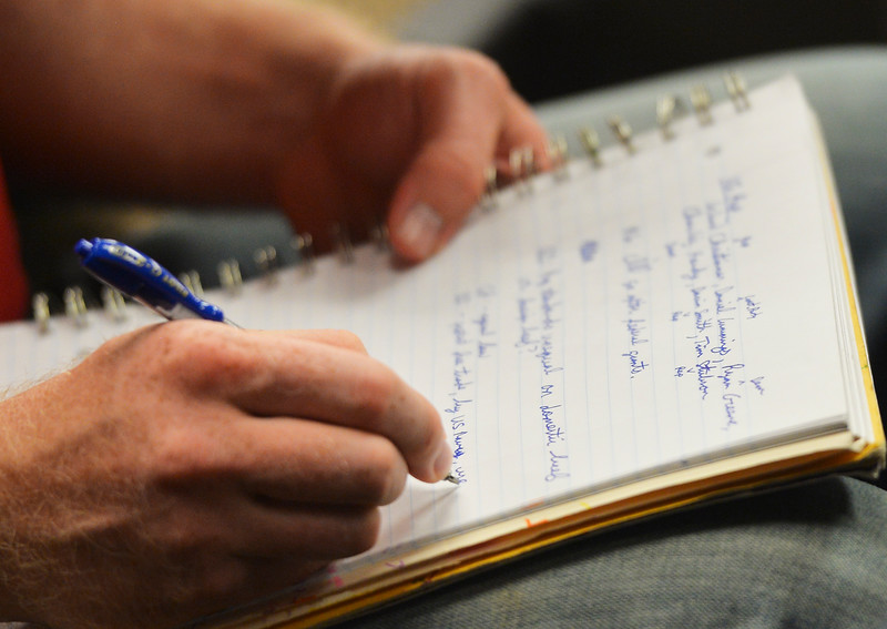 Justin Sheely | The Sheridan Press<br /> A constituent takes notes during the Sheridan County of Commerce's Candidate Forum Tuesday night at the Sheridan Wesleyan Church.