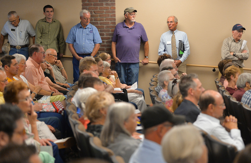 Justin Sheely | The Sheridan Press<br /> Audience members listen to candidates in a standing-room only venue during the Sheridan County of Commerce's Candidate Forum Tuesday night at the Sheridan Wesleyan Church.
