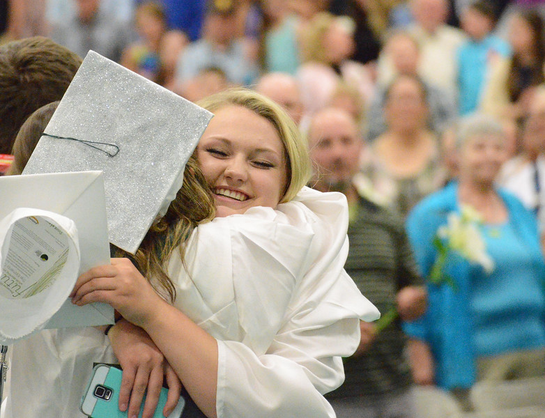 Mike Dunn | The Sheridan Press.<br /> Madison Boll, right, hugs a classmate after the commencement ceremony at Tongue River High School.